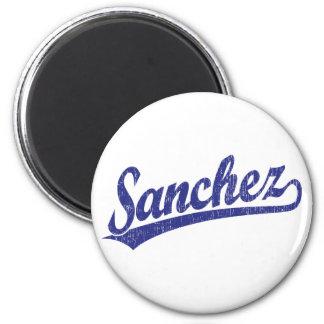Sanchez script logo in blue 2 inch round magnet