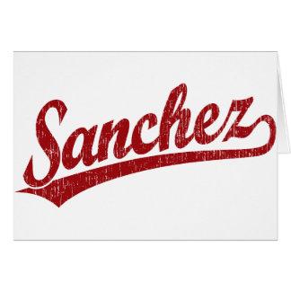 Sanchez script logo in red card