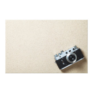 Sand Background With Old Retro Camera Stretched Canvas Print