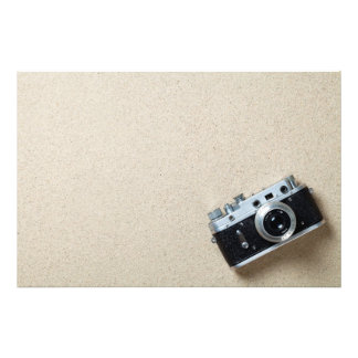Sand Background With Old Retro Camera Photographic Print
