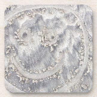 Sand drawing. Sunny smiley face on the beach Drink Coaster
