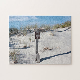 Sand dunes with sign puzzle