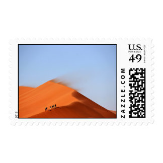 Sand Themed, Men Perched On The Ridge Of Blowing S Stamp