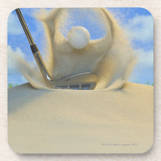 sand wedge hitting a golf ball out of a sand 2 coaster
