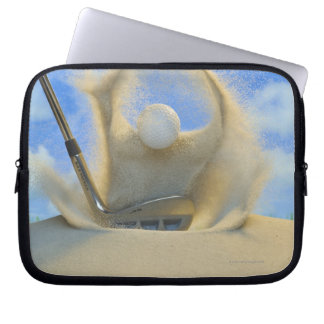 sand wedge hitting a golf ball out of a sand 2 laptop computer sleeves