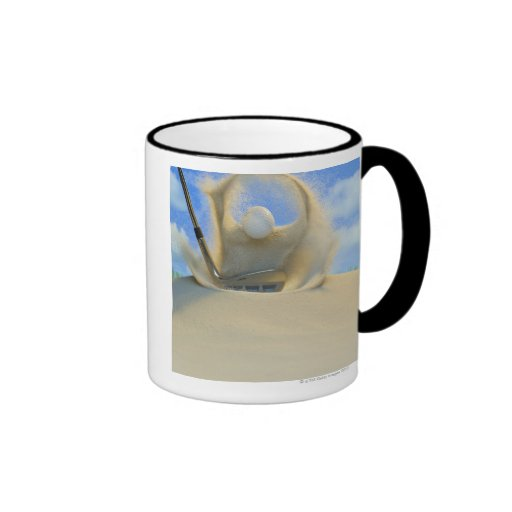sand wedge hitting a golf ball out of a sand 2 coffee mugs