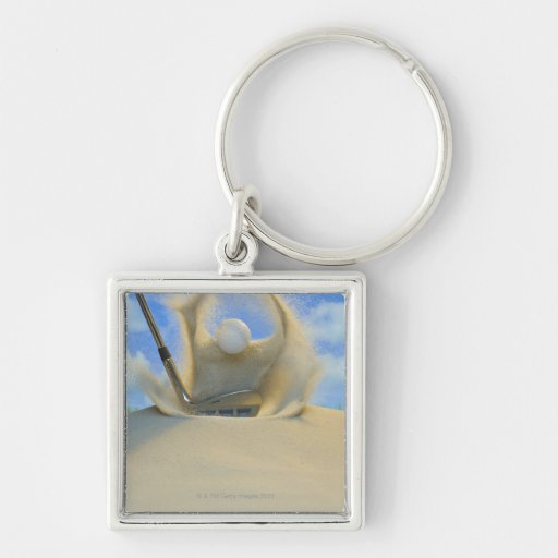 sand wedge hitting a golf ball out of a sand 2 Silver-Colored square keychain