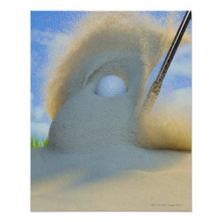 sand wedge hitting a golf ball out of a sand print