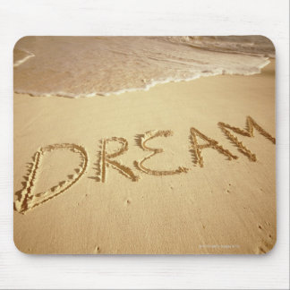 Sand writing Dream with incoming surf at top Mousepads