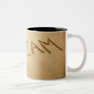 Sand writing Dream with incoming surf at top Coffee Mug