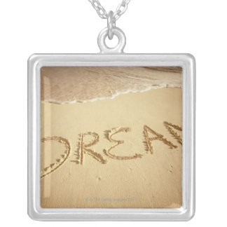 Sand writing 'Dream' with incoming surf at top Silver Plated Necklace