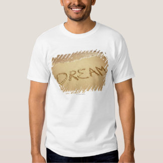 Sand writing 'Dream' with incoming surf at top Tee Shirt