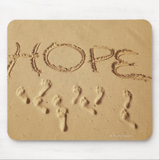 Sand writing Hope on the beach with the Mousepads