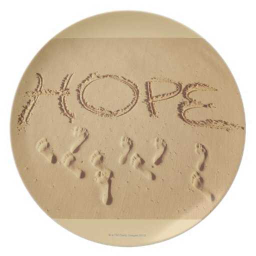 Sand writing ' Hope' on the beach with the Dinner Plates