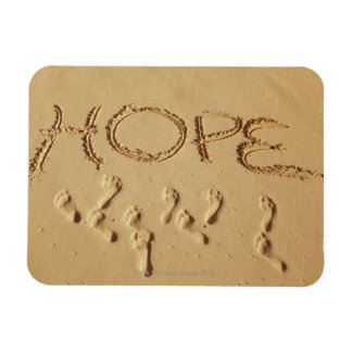 Sand writing ' Hope' on the beach with the Vinyl Magnets