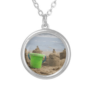 sandcastles on the beach round pendant necklace