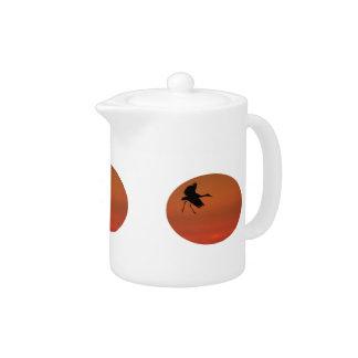 sandhill crane walking on air teapot