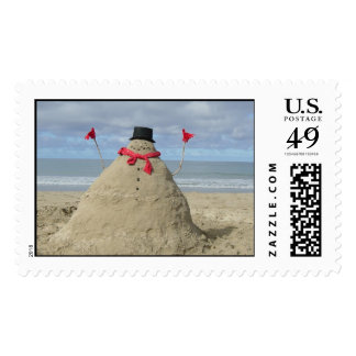 Sandman on beach postage