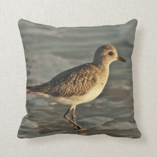 Sandpiper standing in ocean on the beach throw pillow