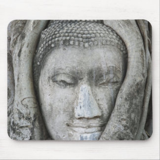 Sandstone head of Buddha surrounded by tree Mouse Pad