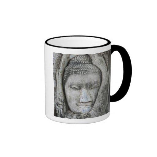 Sandstone head of Buddha surrounded by tree Ringer Coffee Mug