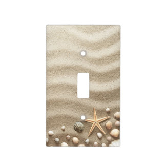 Sandy background with shells and starfish light switch cover