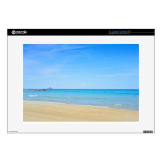 "Sandy beach and blue Mediterranean sea 15"" Laptop Skin"