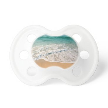 Beach Themed Sandy beach at noon with blue water and clear sky pacifier