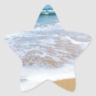 Sandy beach sea waves and mountain at coast star sticker