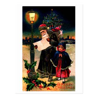 Santa 1910 que comprueba su lista postales