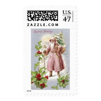 Santa 1916 en capa rosada con el árbol estampillas