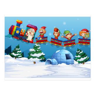 Santa and elf riding on train postcard