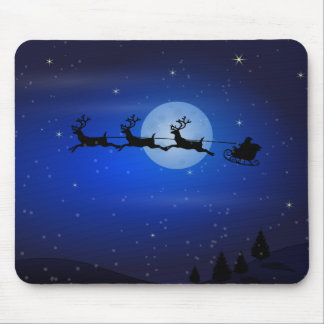 Santa and his reindeers flying at night mouse pad