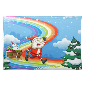 Santa and his sleigh walking at the rainbow cloth placemat