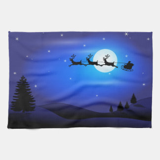 Santa and Reindeer Flying Across Blue Night Sky Kitchen Towel