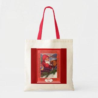 Santa and the sleigh tote bag