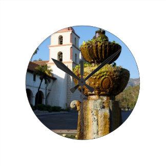 Santa Barbara Mission Fountain Round Wall Clocks