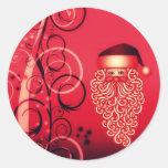 Santa carmesí hace frente a la postal del navidad pegatina