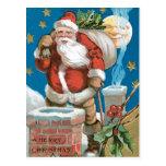 Santa, chimenea, luna, y estrellas postales