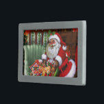 "Santa Claus 2 Belt Buckle<br><div class=""desc"">A cute Santa Claus is coming with a fully packed bag with gifts and a christmas tree! Click on Customize to personalized the gift product! Artwork by GraphicMarket!</div>"
