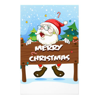Santa Claus at the back of a wooden signboard Stationery