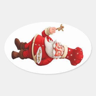 Santa Claus Bakes Gingerbread Men Oval Sticker