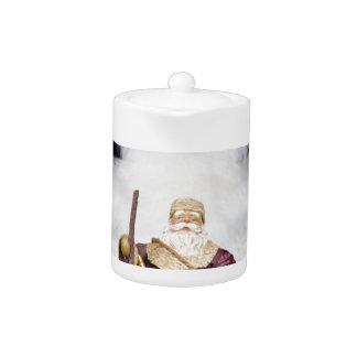 Santa Claus figurine white christmas tree on black Teapot