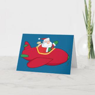 Santa-Claus-Flying-A-Plane-And-Waving