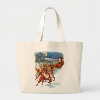 Santa Claus Flying With His Reindeer Guided Sleigh Canvas Bags