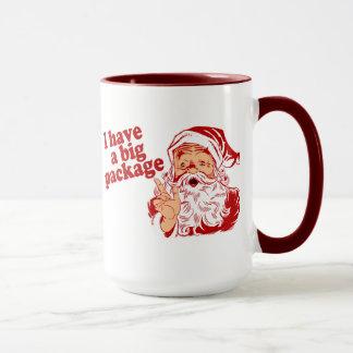 Santa Claus has a big package Mug