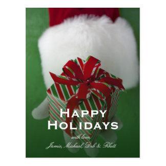 Santa Claus holding Christmas gift Postcard
