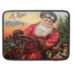 Santa Claus in Automobile MacBook Pro Sleeves