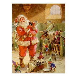 Santa Claus in his North Pole Reindeer Stables Postcard