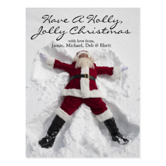 Santa Claus making snow angel outdoors Postcard